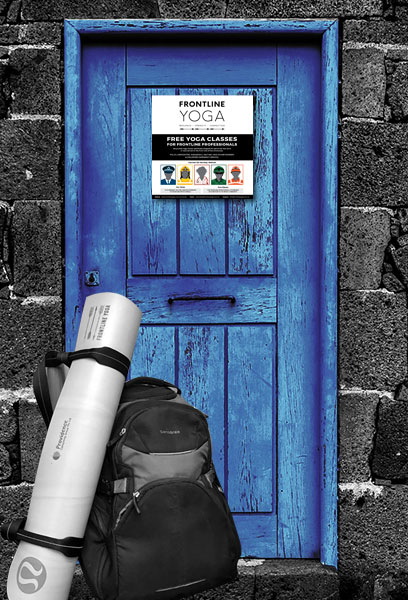 yoga mat and backpack in front of a blue door
